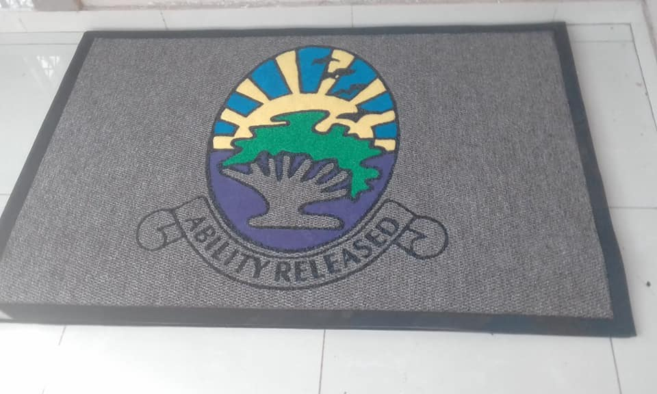 ability released logo mat with a grey background