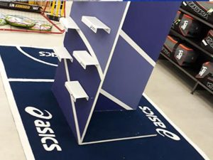 asics promotional mat fitted around shoe shelves