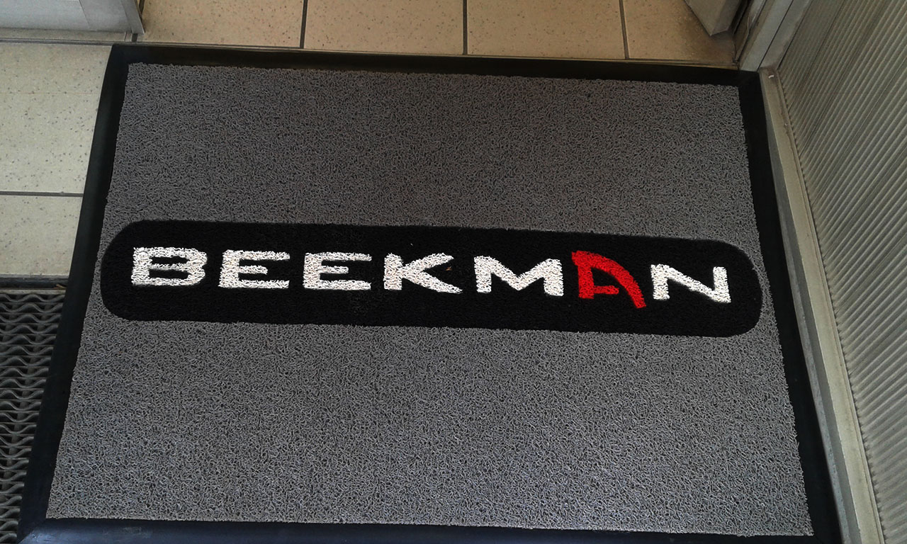 beekman logo mat. its made from spaghetti or vinyl loop like mat