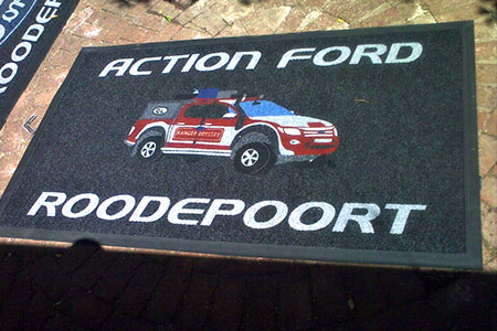 action ford branded mat. the logo is a ctually in the form of a ford truck
