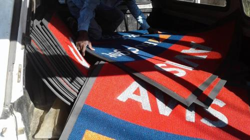 avis budget logo mats being packed.