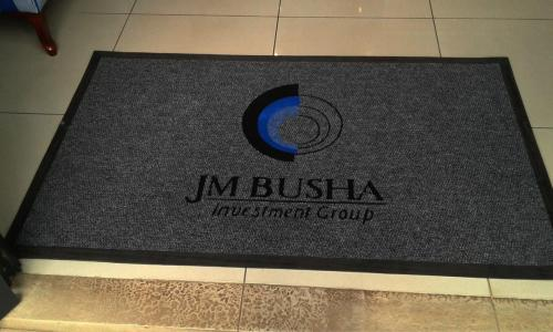 busha logo mat/ promotional mat made from steelgrey berberpoint carpet