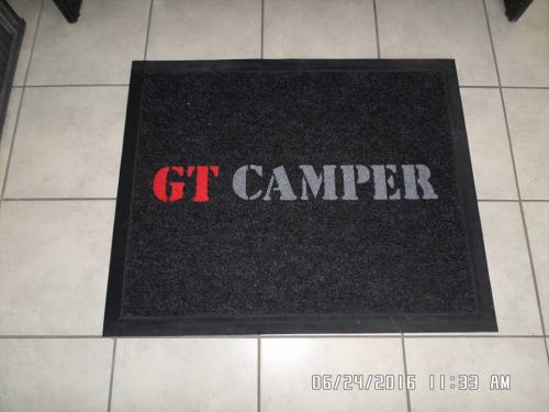 gt camper logo mats with a black background