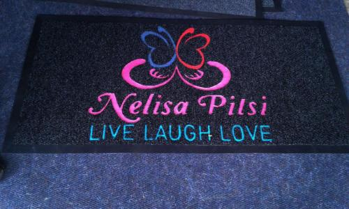 nelisa  personalised mat with pink lettering