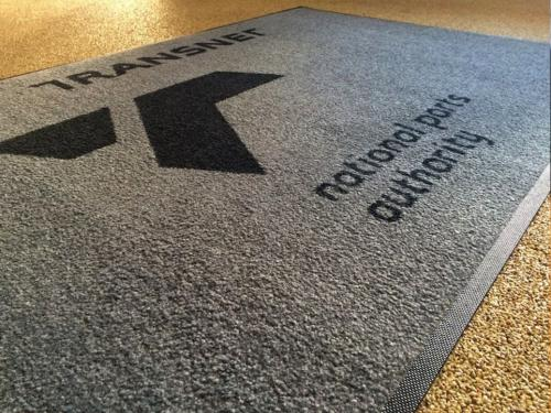 transnet promotional mat . the material used is iron horse dirt trapper carpet